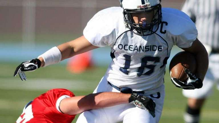 Oceanside running back Nick Sherry tries to break