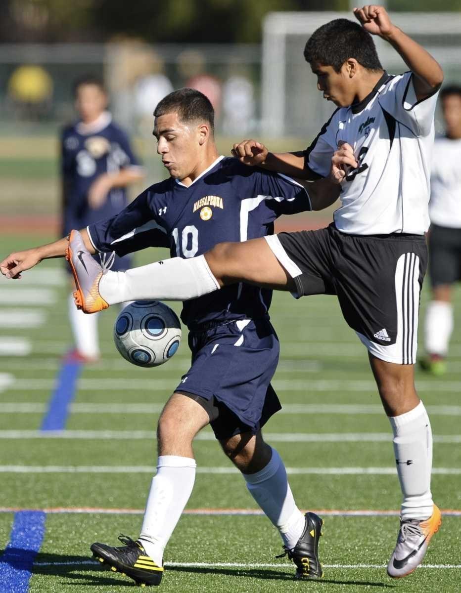 Farmingdale's Fernando Cortez, right, battles for the ball