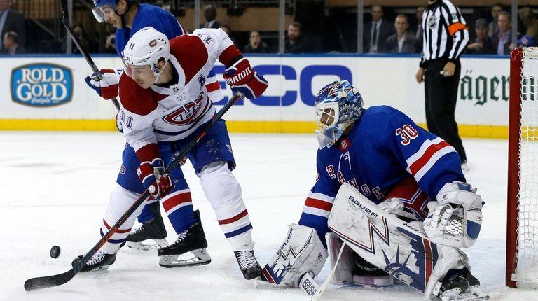 Rangers goaltender Henrik Lundqvist makes a save during