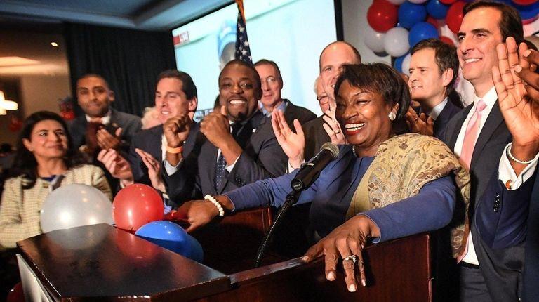 Sen. Andrea Stewart-Cousins, at podium, celebrates her victory