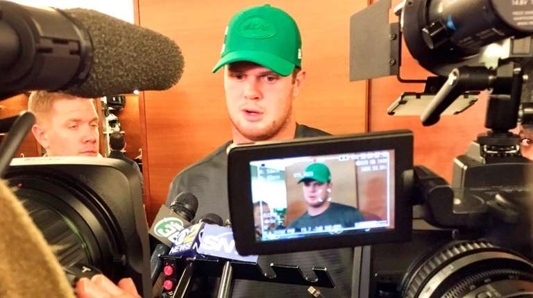 Jets quarterback Sam Darnold talks with the media