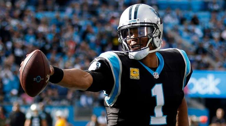 Panthers quarterback Cam Newton runs with the football