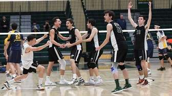 Bellmore JFK players celebrate their win against Jericho