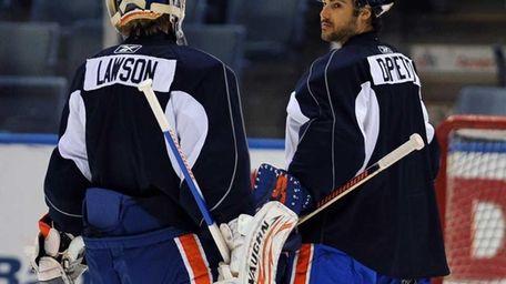 Islanders goalies Nathan Lawson, left, and Rick DiPietro