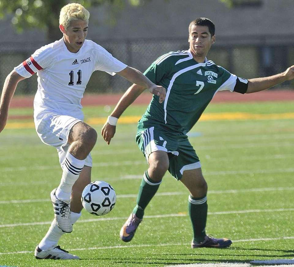 Commack's Vincent Iannitelli, left, moves the ball downfield