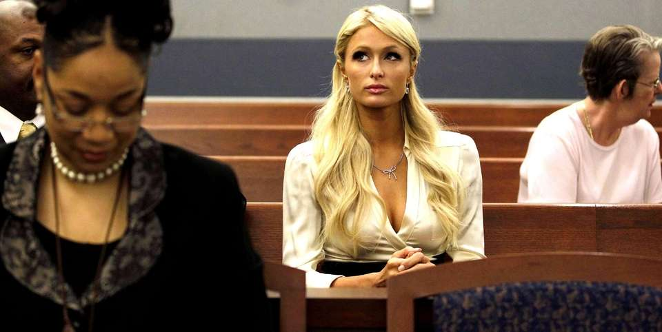 Paris Hilton waits for her hearing to start