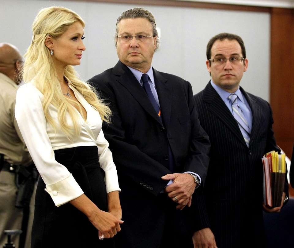 Paris Hilton listens to questions from the judge