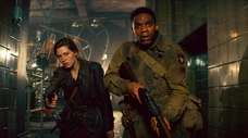 "Mathilde Ollivier and Jovan Adepo in ""Overlord."""