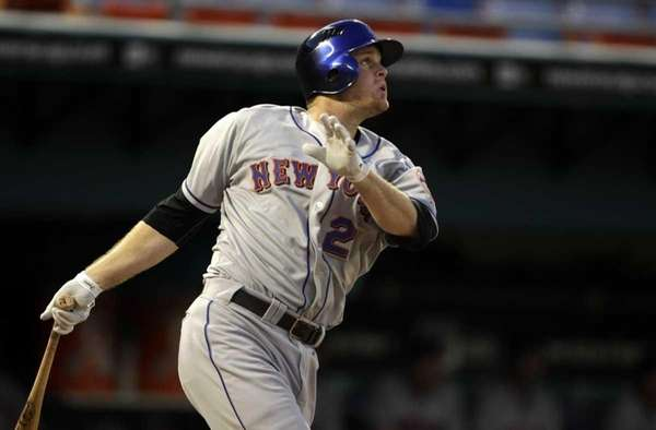 The Mets' Lucas Duda follows through on a