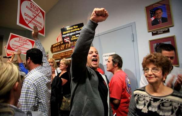 A resident cheers after Huntington Town board voted