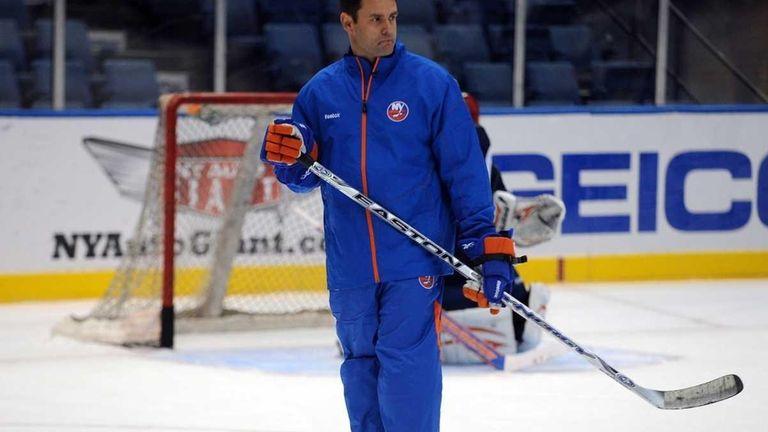 Islanders head coach Scott Gordon keeps an eye