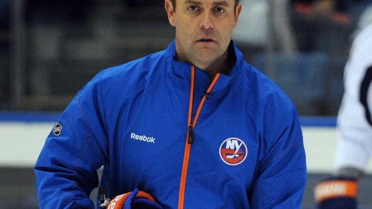 New York Islanders coach Scott Gordon skates during
