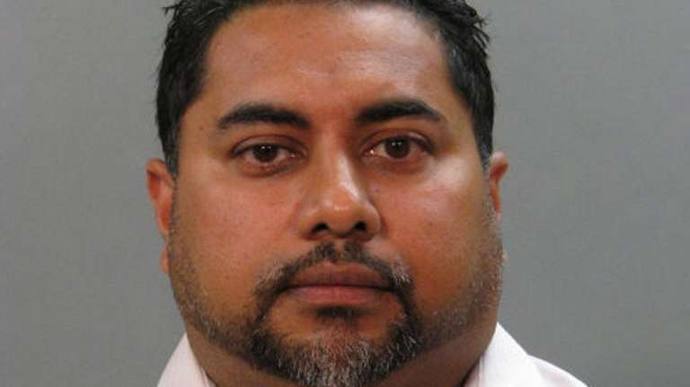 Peter Singh, of Selden, pleaded guilty to embezzling