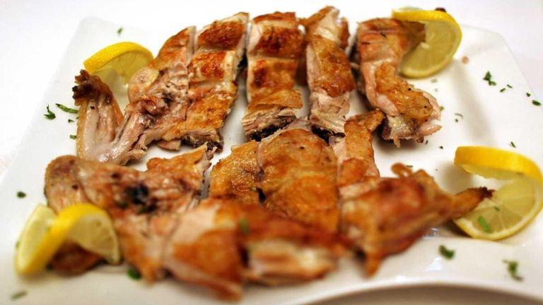 Frango de churrasco, a Portuguese grilled chicken, is