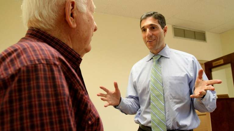 Republican U.S. congressional candidate Randy Altschuler chats with