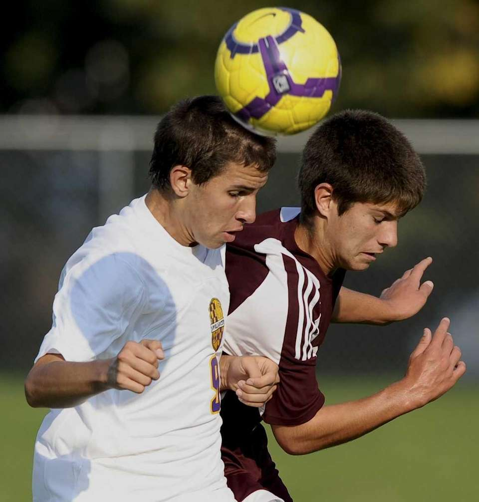 Sayville's #9 Jon Paciorek heads the ball past