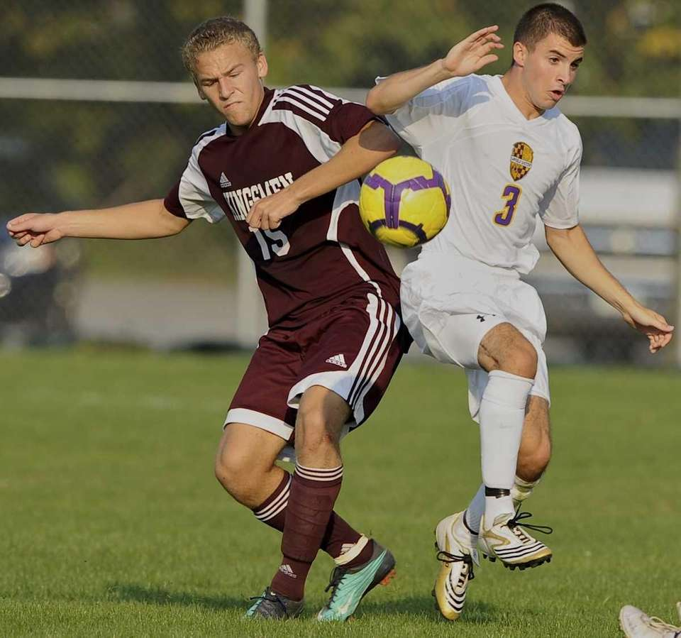 Kings Park's #15 Scott Weber battles for possession