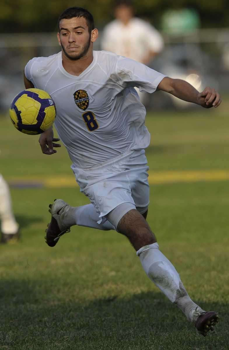 Sayville's Dakota Edwards drives the ball down field