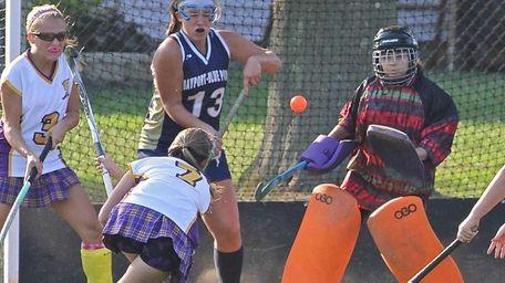 Sayville's Olivia Cabral #7 scores against Bayport goalie