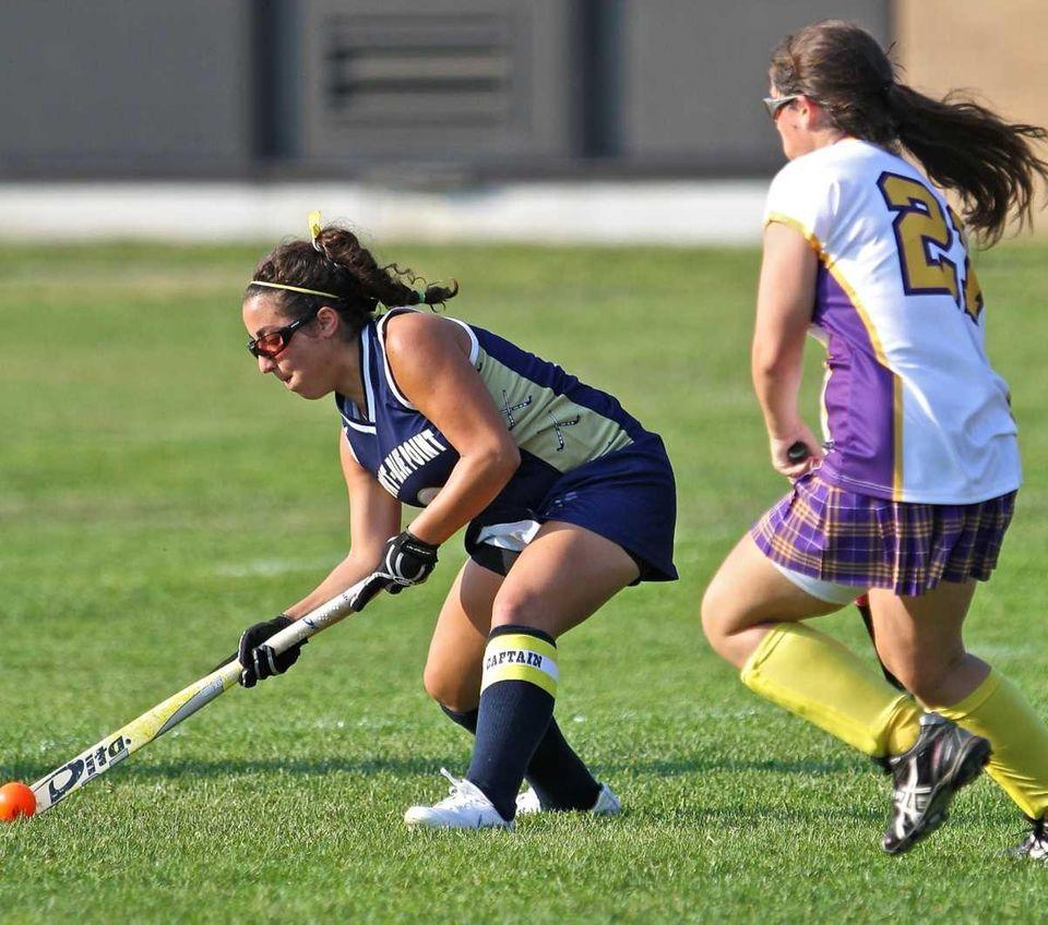 Bayport's Briana Rubenstein #2 tries to deke Sayville's