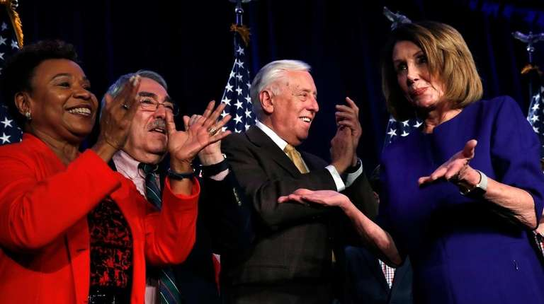 House Minority Leader Nancy Pelosi, right, dances past