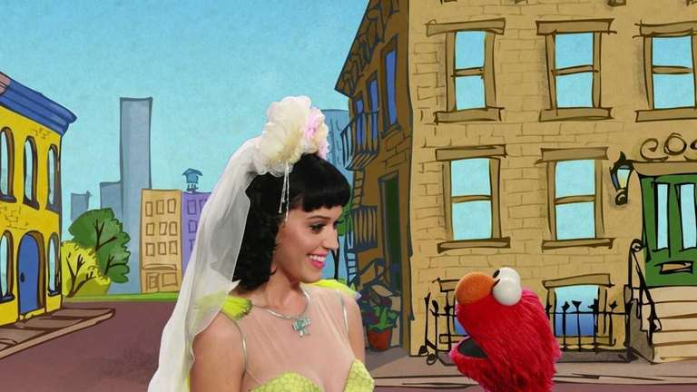 Katy Perry, left, is shown with Elmo performing