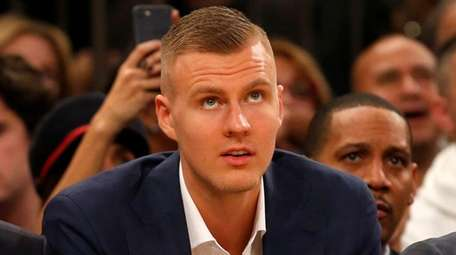 The Knicks' Kristaps Porzingis looks on from the