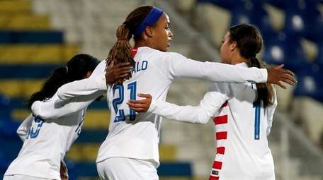 United States forward Jessica McDonald, center, celebrates after