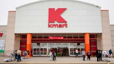 Thanksgiving day shoppers emerge from the Kmart in