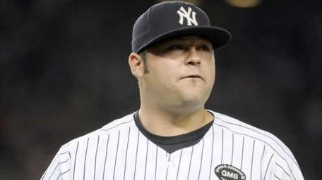New York Yankees' relief pitcher Joba Chamberlain leaving