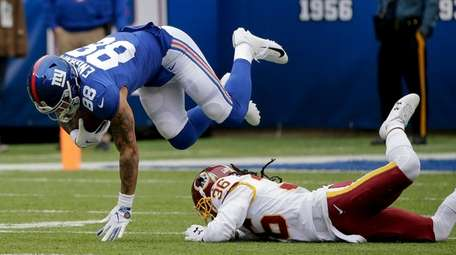 Giants tight end Evan Engram is tripped up