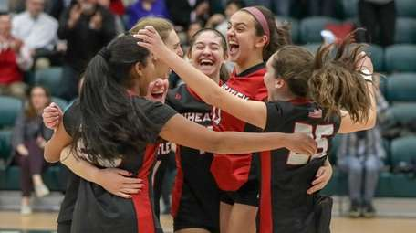 Wheatley players celebrate after defeating Island Trees in