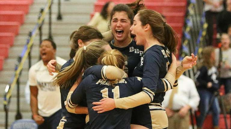 Bayport-Blue Point players celebrate their win during the