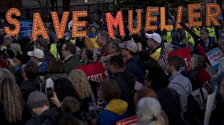 Demonstrators rally in Washington to demand protection for