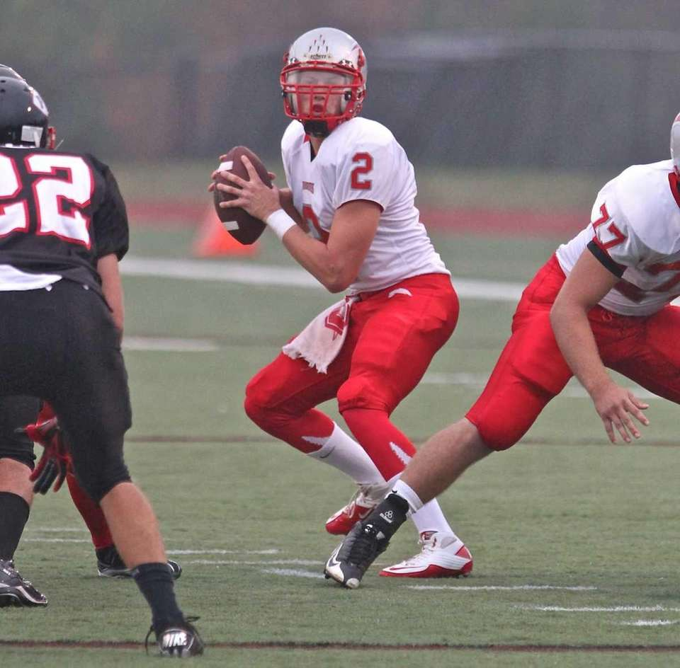 Connetquot's quarterback Kevin Jadick #2, drops back for