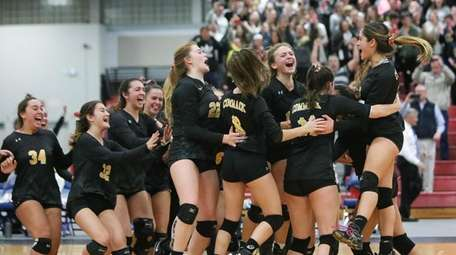 Commack players celebrate their win in the Suffolk