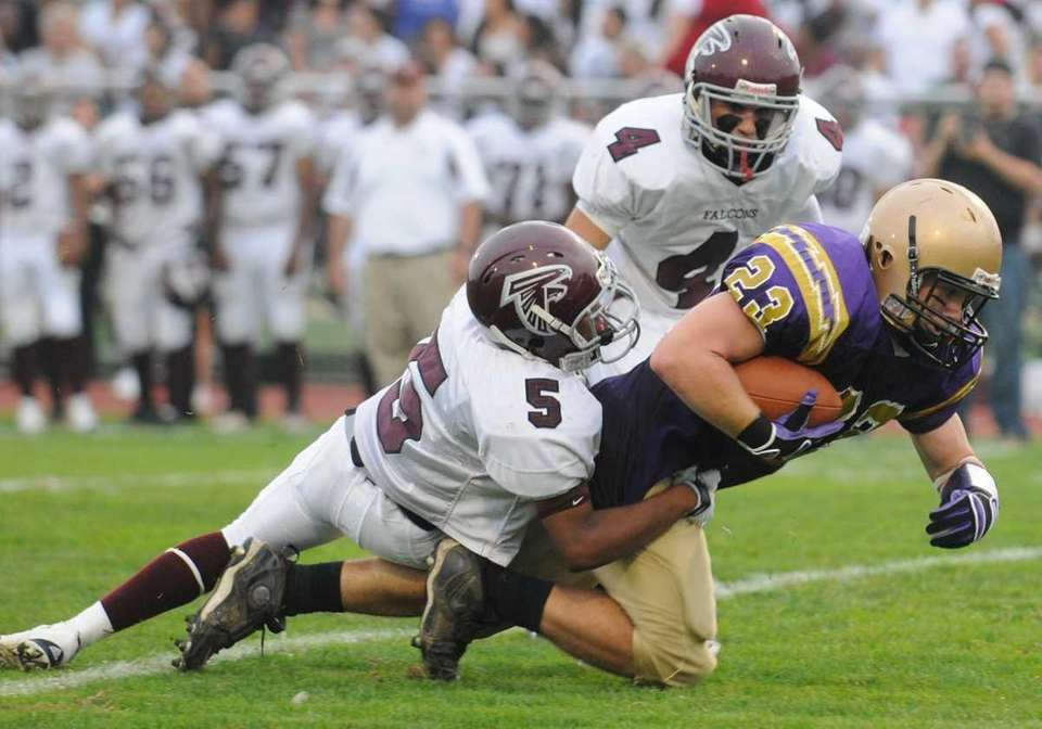 Sayville High School #23 Richard Millwater, right, stretches