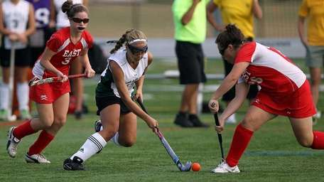 Ward Melville's Deryn Blaney (22) drives between Smithtown