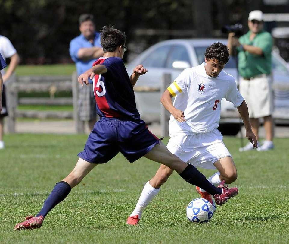 Cold Spring Harbor's Chris Pontisakos chases Friends Academy's