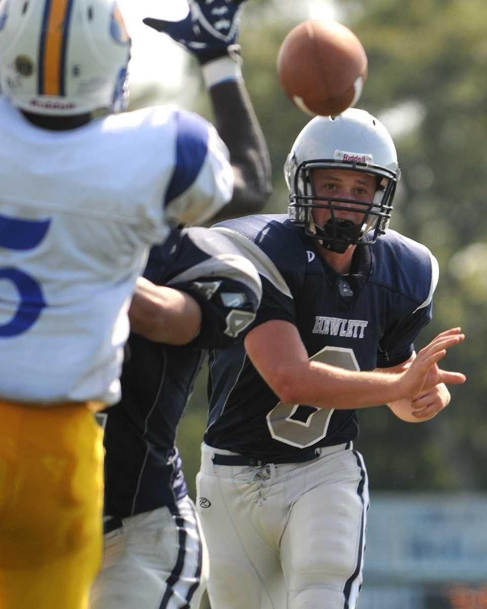 Hewlett quarterback #8 Alex Kahn throws a pass