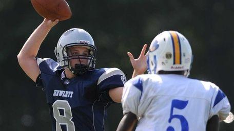 Hewlett quarterback Alex Kahn throws a pass as