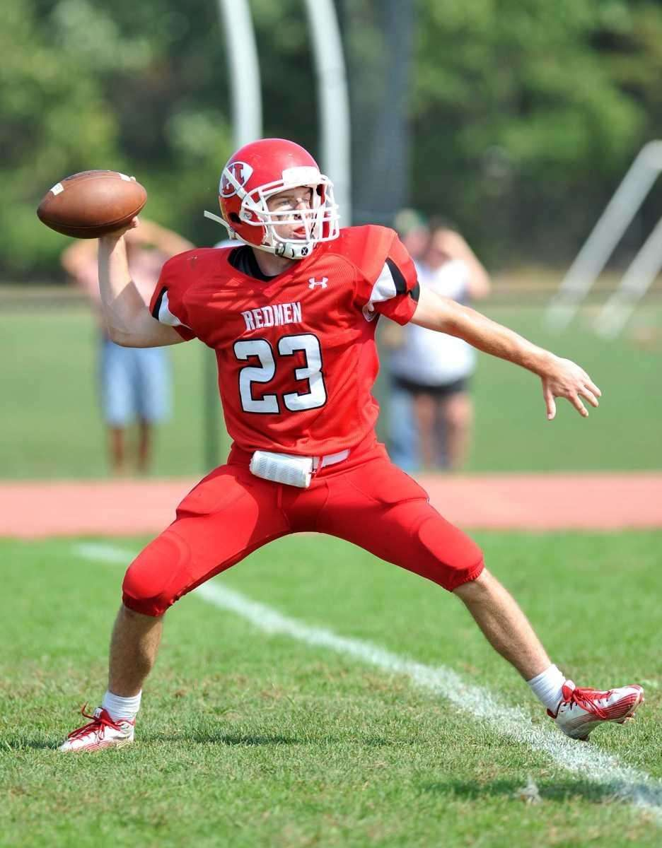East Islip quarterback Kevin Hutchinson drops back to