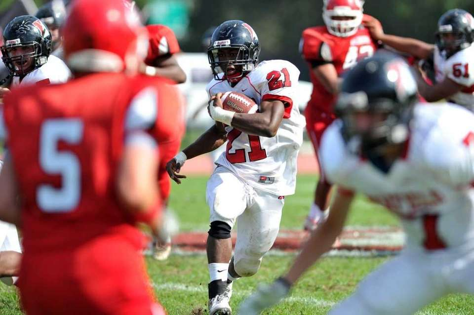 Newfield running back Shervon Barthelmy runs with the