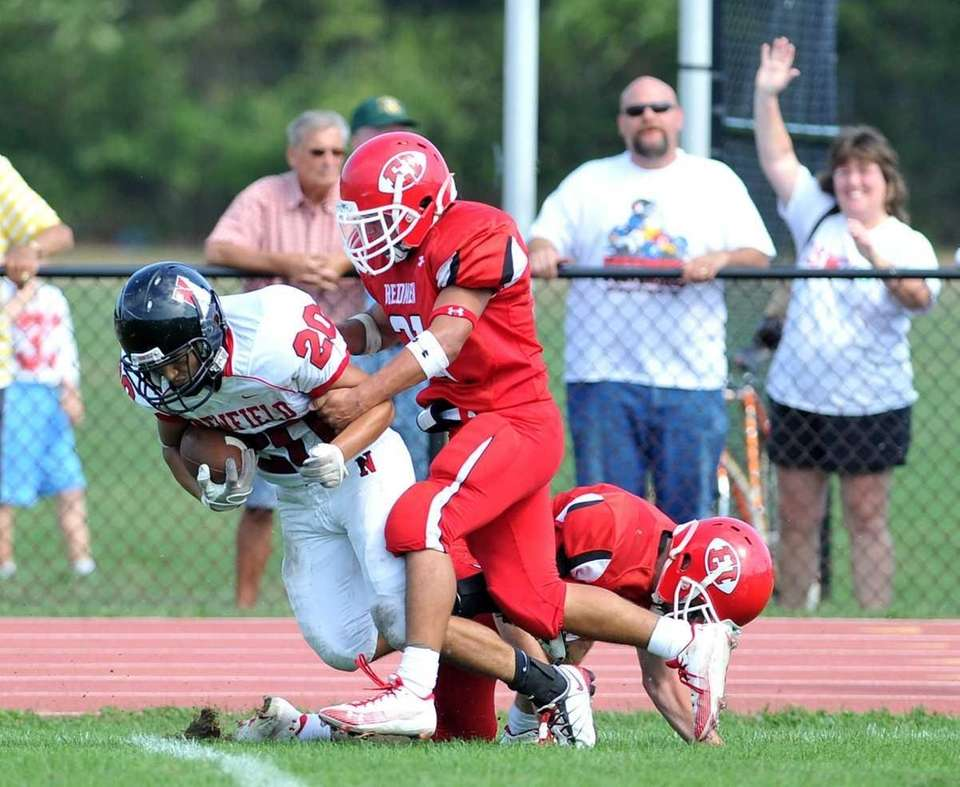East Islip defensive back Joe Modica tackles Newfield
