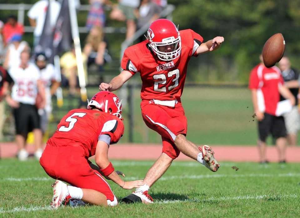 East Islip quarterback Kevin Hutchinson kicks the extra