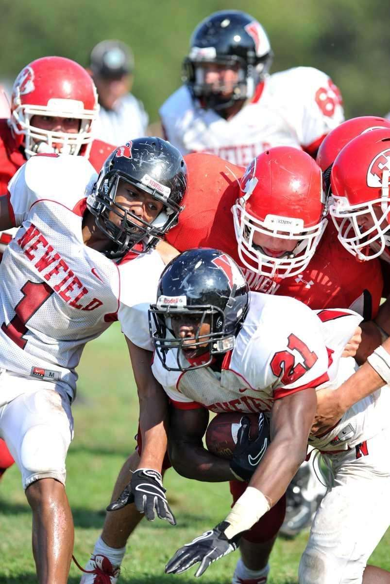 Newfield running back Shervon Barthelmy is tackled during