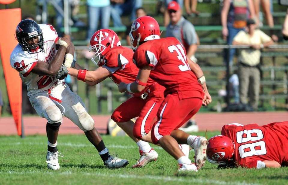 Newfield running back Shervon Barthelmy breaks a tackle