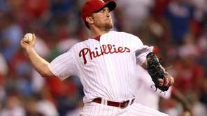 Philadelphia Phillies closer Brad Lidge rears back on