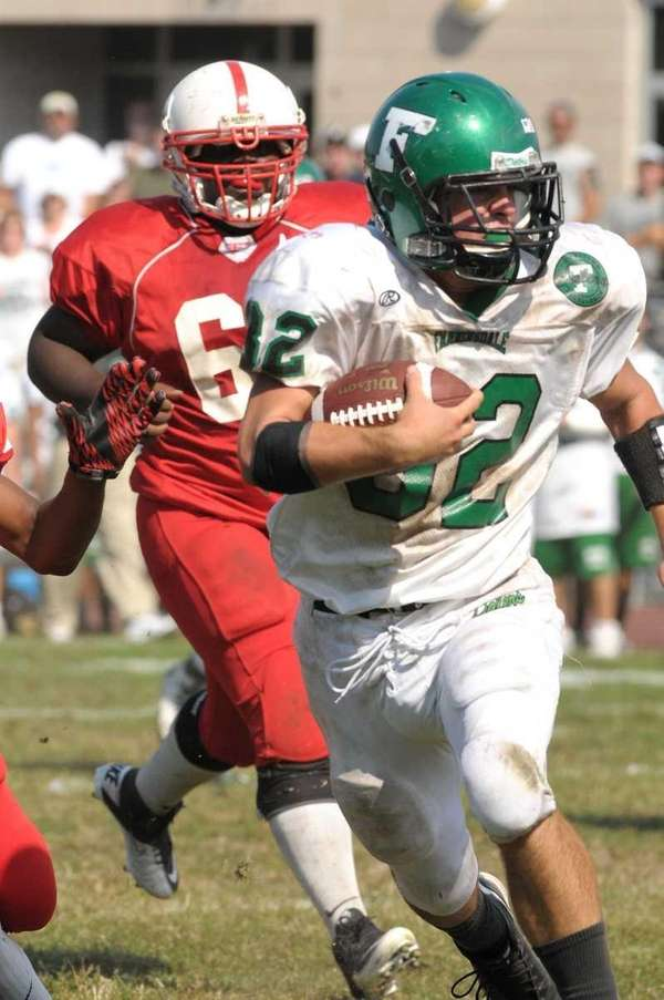 Farmingdale's Kevin Wahl runs for yardage as Freeport's