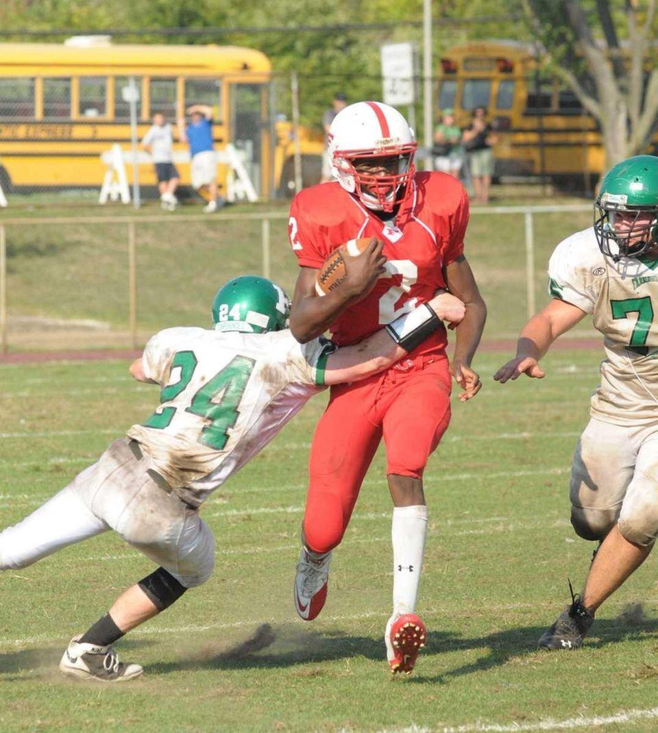 Freeports's QB Isaiah Barnes tries to run past